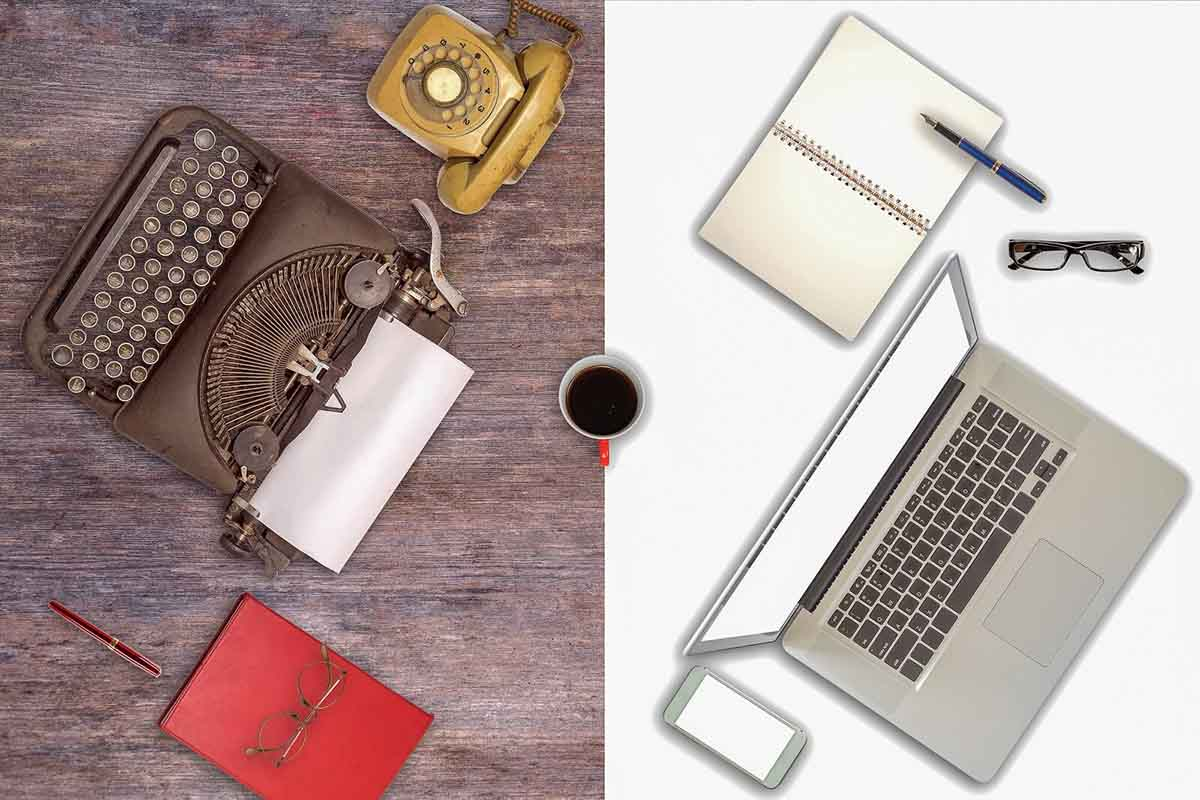 Old fashioned type  writer and modern laptop symbolising digital transformation