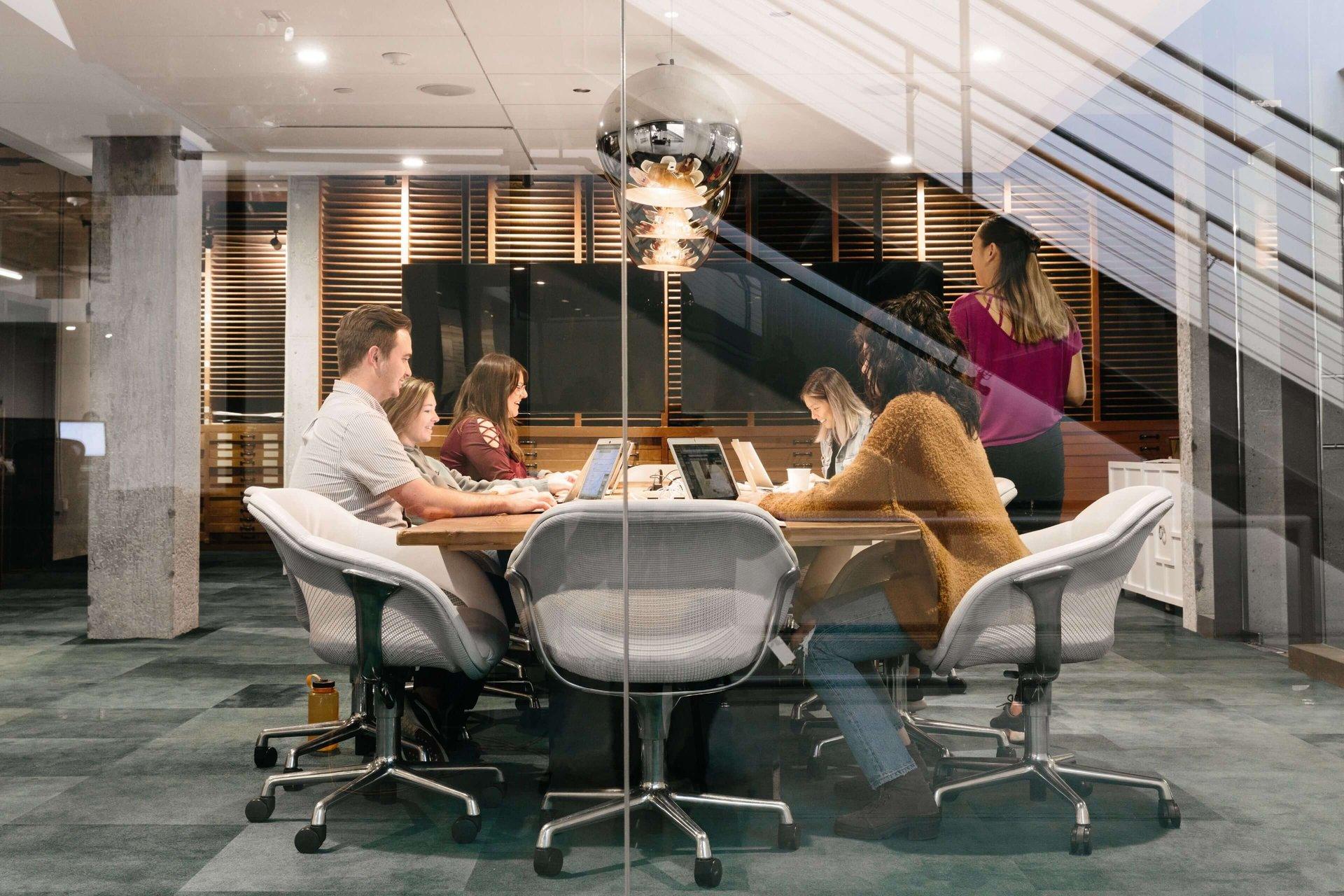 People sitting around a meeting room