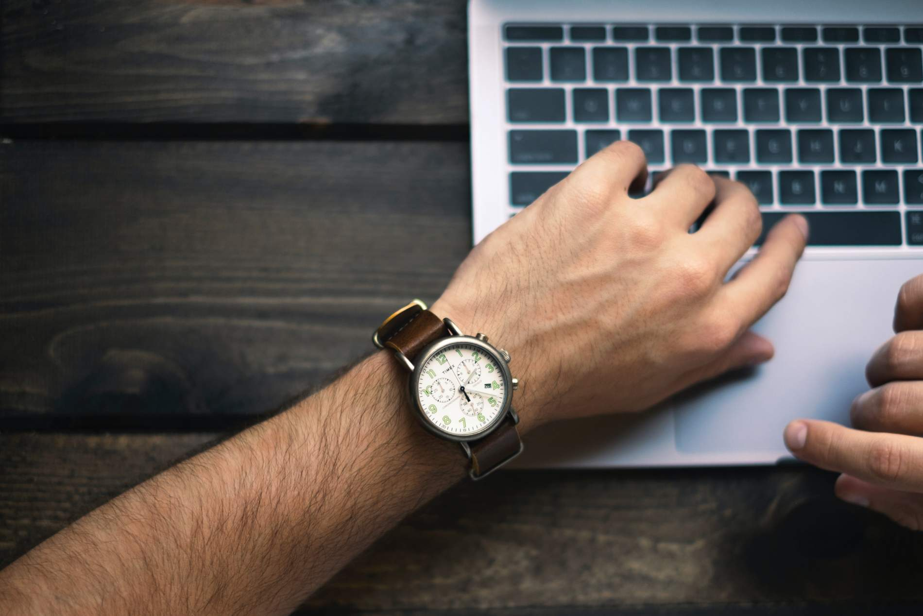 A watch on a man's wrist - illustrating tracking billable hours