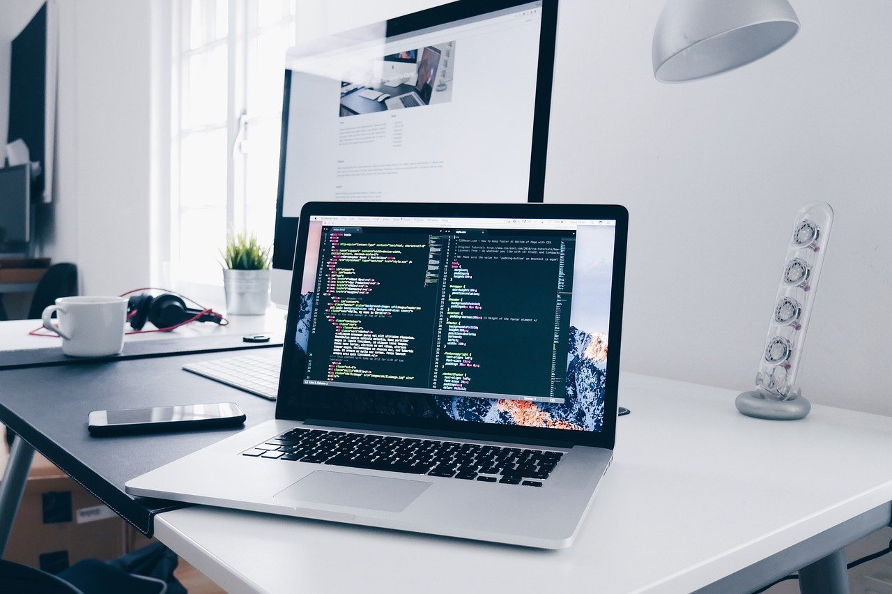 laptop on desk (How tech can improve efficiency in your asset management firm)