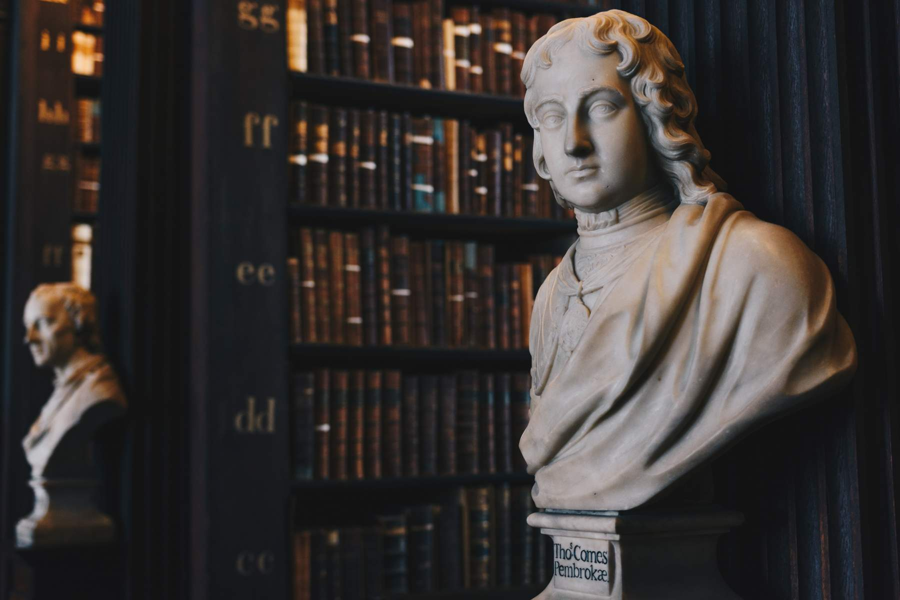 statue of a figure in a library