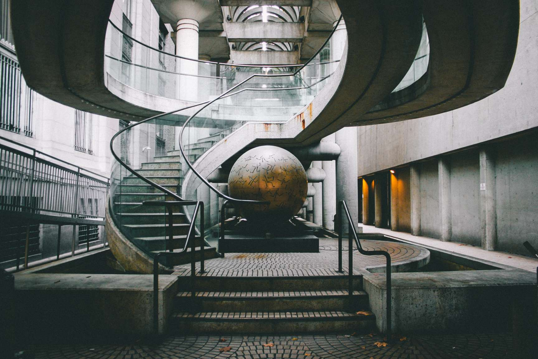 Sculpture in a building surrounded by a circular staircase