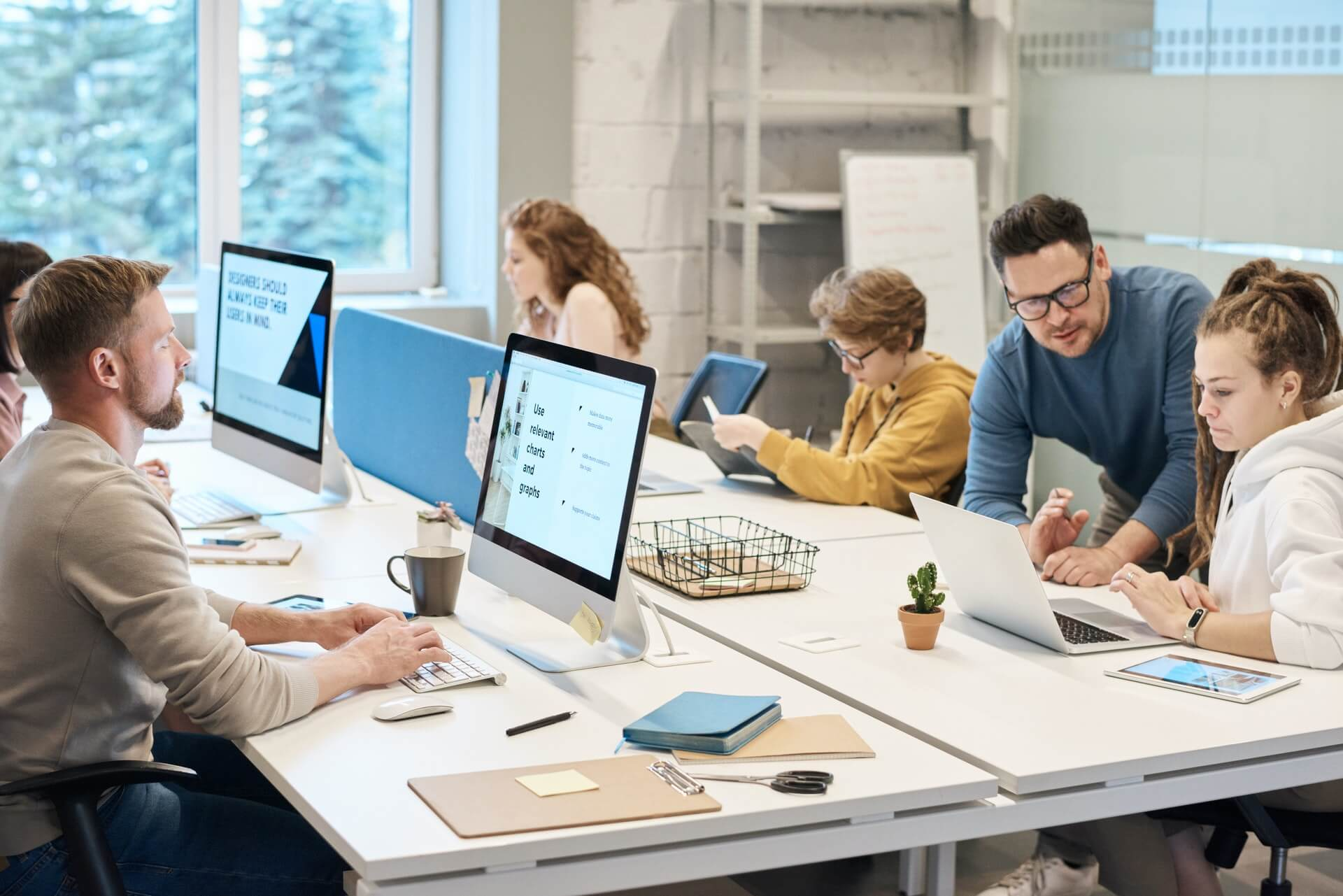 People in an office (pic for 4 technologies that will help you get back to the office blog)